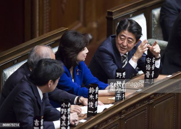 Shinzo Abe Japan's prime minister right speaks with Seiko Noda Japan's internal affairs and communications minister center during a plenary session...