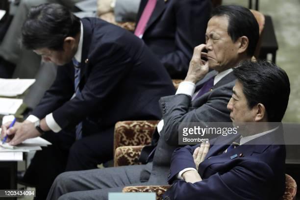 Shinzo Abe, Japan's prime minister, right, Taro Aso, deputy prime minister and finance minister, second right, and Toshimitsu Motegi, foreign...