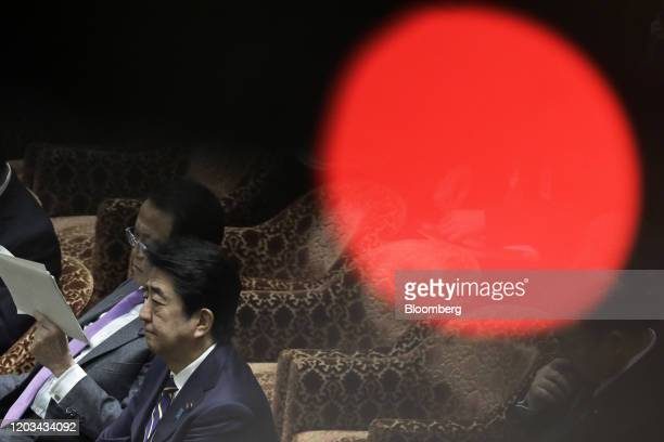 Shinzo Abe, Japan's prime minister, second left, and Taro Aso, deputy prime minister and finance minister, attend a budget committee session at the...