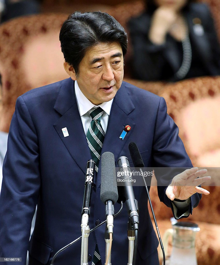 Shinzo Abe, Japan's prime minister, speaks during a budget committee session at the upper house of parliament in Tokyo, Japan, on Wednesday, Feb. 20, 2013. Abe said that the need to buy foreign bonds has decreased, backing away from a policy proposal that may be seen by other nations as a direct attempt to weaken the yen. Photographer: Haruyoshi Yamaguchi/Bloomberg via Getty Images