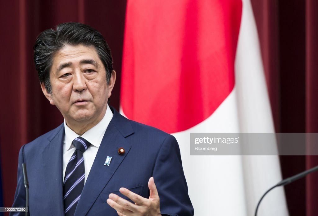 Shinzo Abe, Japan's prime minister, speaks during a joint news conference with Jean-Claude Juncker, president of the European Commission, and Donald Tusk, president of the European Union (EU), following a summit at the prime minister's official residence in Tokyo, Japan, on Tuesday, July 17, 2018. Japan and the EU signed a trade agreement on Tuesday in Tokyo that lowers barriers on the movement of goods and services between the two economies and provides a counterweight to U.S. protectionism. Photographer: Tomohiro Ohsumi/Bloomberg via Getty Images