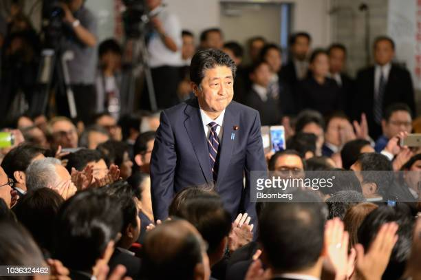 Shinzo Abe Japan's prime minister takes a bow after being announced the winner of the Liberal Democratic Party's presidential election at its...