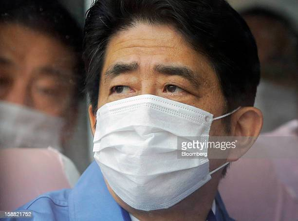 Shinzo Abe Japan's prime minister tours Tokyo Electric Power Co's Fukushima DaiIchi nuclear power plant in Okuma Town Fukushima Prefecture Japan on...