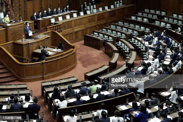 Shinzo Abe, Japan's prime minister, wearing a protective mask, speaks during a plenary session at the upper house of parliament in Tokyo, Japan, on...