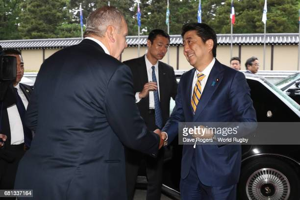 Shinzo Abe Prime Minister of Japan is greeted upon arrival by Bill Beaumont Chairman of World Rugby via Getty Images during the Rugby World Cup 2019...