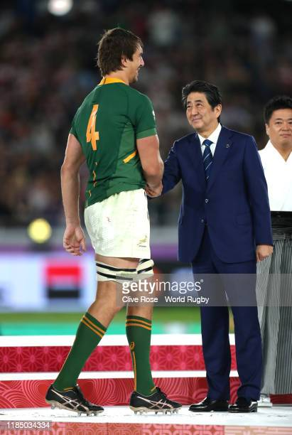 Shinzo Abe Prime Minister of Japan shakes hands with Eben Etzebeth of South Africa after the Rugby World Cup 2019 Final between England and South...