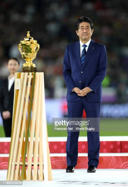 Shinzo Abe Prime Minister of Japan stands next to the Web Ellis Cup after the Rugby World Cup 2019 Final between England and South Africa at...