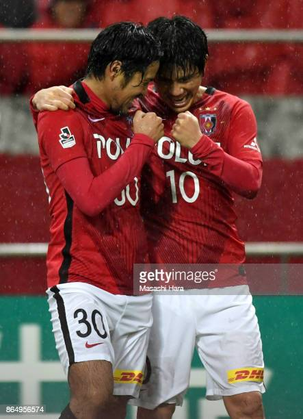 Shinzo Koroki and Yosuke kashiwagi of Urawa Red Diamonds celebrate the third goal during the JLeague J1 match between Urawa Red Diamonds and Gamba...