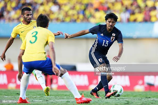 Shinzo Koroki of Japan in action during the international friendly match between Japan and Brazil at the Estadio Serra Dourada on July 30 2016 in...