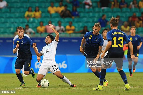 Shinzo Koroki of Japan is challenged by Alexander Milosevic of Sweden during the Men's Football Group B match between Japan and Sweden at Arena Fonte...