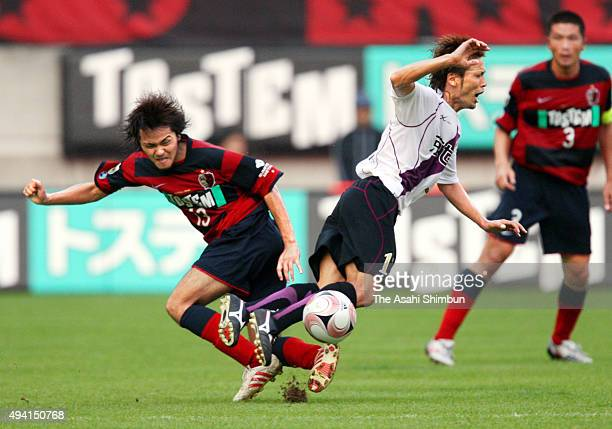 Shinzo Koroki of Kashima Antlers and Atsusih Yanagisawa of Kyoto Sanga compete for the ball during the JLeague match between Kashima Antlers and...