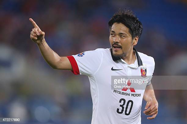 Shinzo Koroki of the Red Diamonds celebrates after scoring a goal during the Asian Champions League match between the Brisbane Roar and Urawa Red...