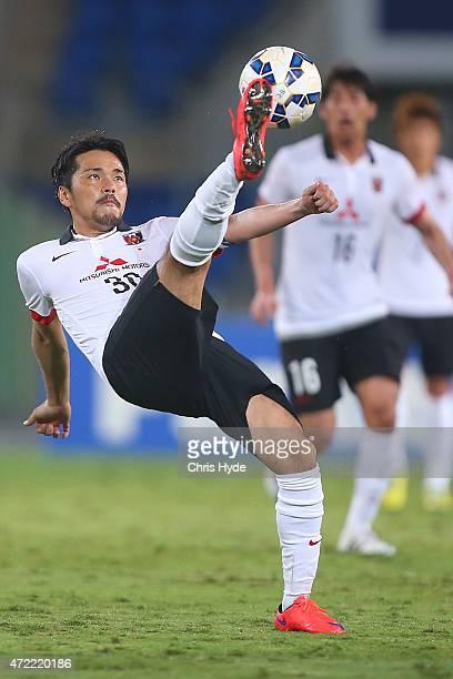 Shinzo Koroki of the Red Diamonds kicks during the Asian Champions League match between the Brisbane Roar and Urawa Red Diamonds at Cbus Super...