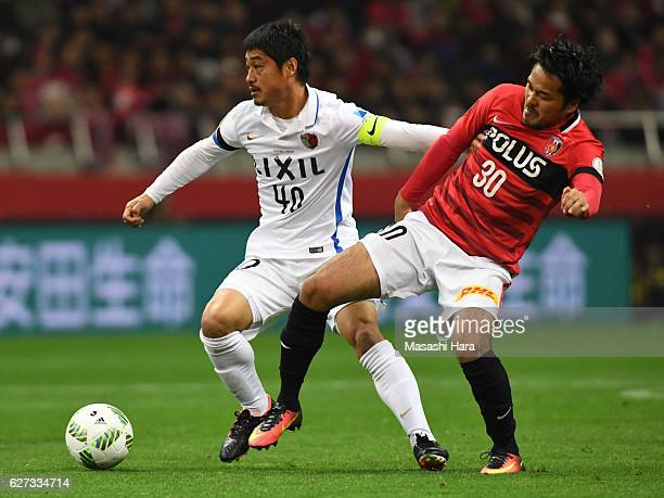 Shinzo Koroki of Urawa Red Diamonds and Mitsuo Ogasawara of Kashima Antlers compete for the ball during the JLeague Championship Final second leg...