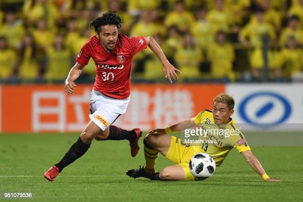 Shinzo Koroki of Urawa Red Diamonds and Ryuta Koike of Kashiwa Reysol compete for the ball during the JLeague J1 match between Kashiwa Reysol and...
