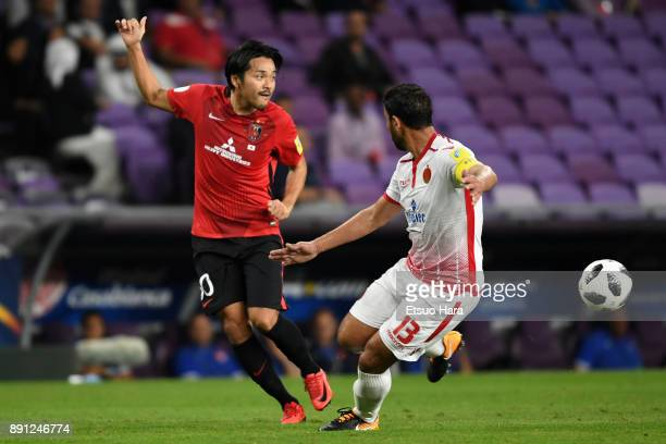 Shinzo Koroki of Urawa Red Diamonds and Youssef Rabeh of Wydad Casablanca compete for the ball during the FIFA Club World Cup UAE 2017 Match for 5th...