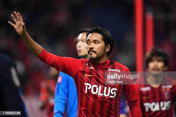Shinzo Koroki of Urawa Red Diamonds applauds fans after the J.League J1 match between Urawa Red Diamonds and Kawasaki Frontale at Saitama Stadium on...