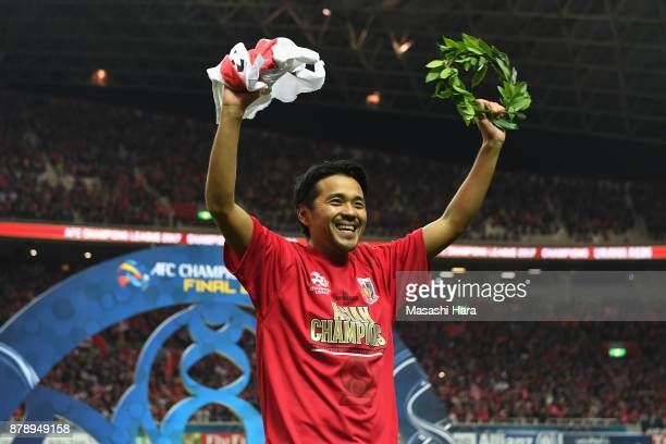 Shinzo Koroki of Urawa Red Diamonds applauds supporters after the AFC Champions League Final second leg match between Urawa Red Diamonds and AlHilal...