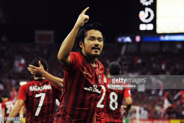 Shinzo Koroki of Urawa Red Diamonds celebrates his team's first goal scored by an own goal from Yan Junling of Shanghai during the AFC Champions...