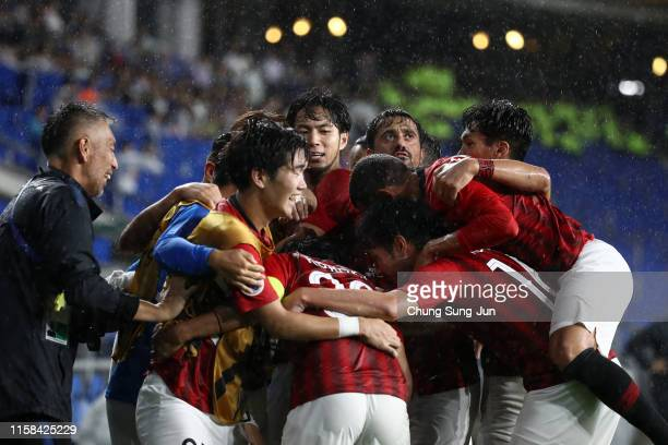 Shinzo Koroki of Urawa Red Diamonds celebrates scoring his side's second goal with his team mates during the AFC Champions League round of 16 second...