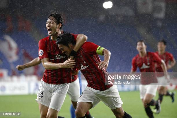 Shinzo Koroki of Urawa Red Diamonds celebrates scoring his side's second goal with his team mate Kenyu Sugimoto during the AFC Champions League round...