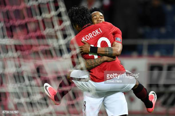 Shinzo Koroki of Urawa Red Diamonds celebrates scoring his team's sixth goal with his team mate Rafael da Silva during the AFC Champions League Group...