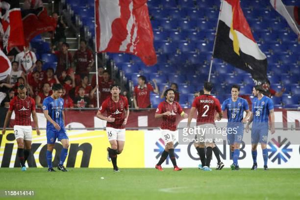 Shinzo Koroki of Urawa Red Diamonds celebrates scoring the opening goal during the AFC Champions League round of 16 second leg match between Ulsan...