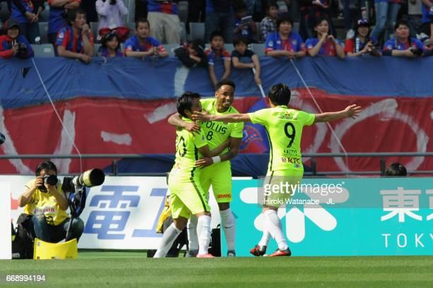 Shinzo Koroki of Urawa Red Diamonds celebrates scoring the opening goal with his team mates Rafael Silva and Yuki Muto during the J.League J1 match...