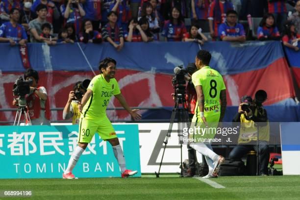 Shinzo Koroki of Urawa Red Diamonds celebrates scoring the opening goal with his team mate Rafael Silva during the J.League J1 match between FC Tokyo...