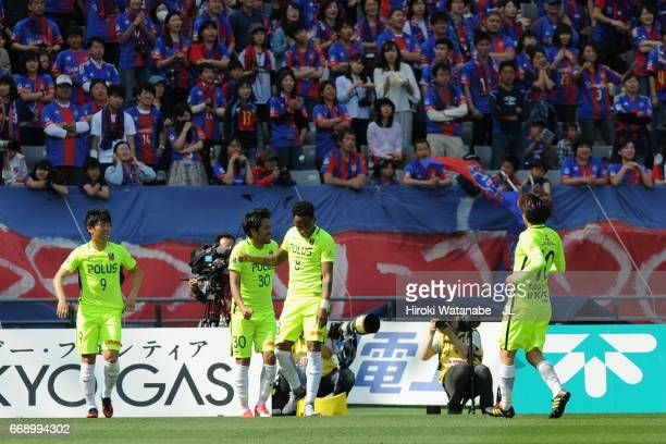 Shinzo Koroki of Urawa Red Diamonds celebrates scoring the opening goal with his team mates during the J.League J1 match between FC Tokyo and Urawa...