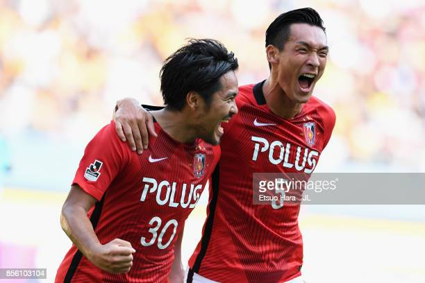 Shinzo Koroki of Urawa Red Diamonds celebrates scoring the opening goal with his team mate Tomoaki Makino during the J.League J1 match between...