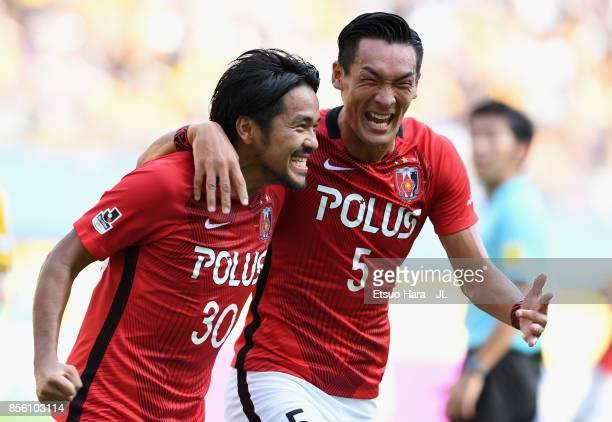 Shinzo Koroki of Urawa Red Diamonds celebrates scoring the opening goal with his team mate Tomoaki Makino during the JLeague J1 match between Vegalta...