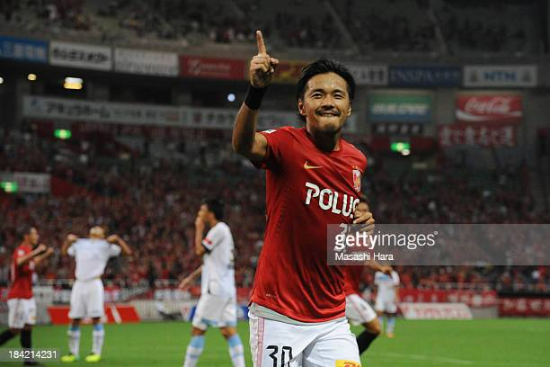 Shinzo Koroki of Urawa Red Diamonds celebrates the first goal during the Yamazaki Nabisco Cup semi final second leg match between Urawa Red Diamonds...
