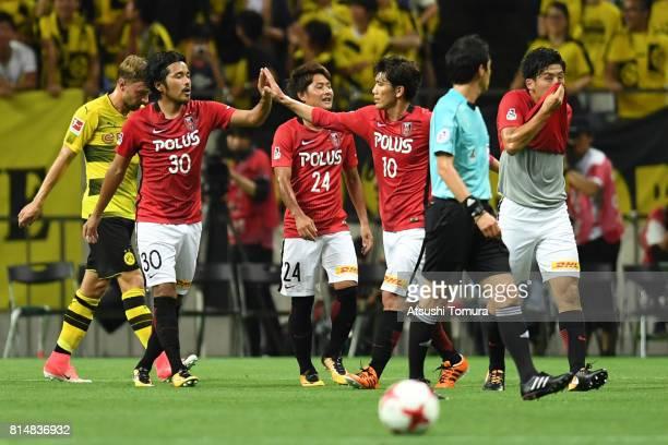 Shinzo Koroki of Urawa Red Diamonds celebrates with his team mates after scoring a goal during the preseason friendly match between Urawa Red...
