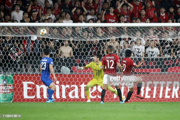 Shinzo Koroki of Urawa Red Diamonds heads the ball to score the opening goal during the AFC Champions League round of 16 second leg match between...
