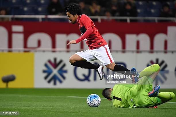 Shinzo Koroki of Urawa Red Diamonds is fouled by goalkeeper Vedran Janjetovic of Sydney FC inside the penalty area during the AFC Champions League...