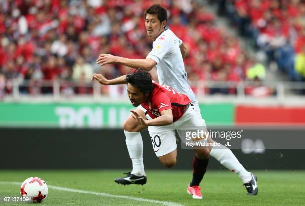Shinzo Koroki of Urawa Red Diamonds is fouled in the area resutling in a penalty kick during the JLeague J1 match between Urawa Red Diamonds and...