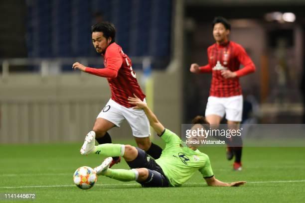 Shinzo Koroki of Urawa Red Diamonds is tackled during the AFC Champions League Group G match between Urawa Red Diamonds and Jeonbuk Hyundai Motors at...