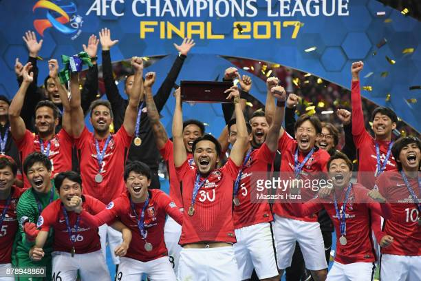 Shinzo Koroki of Urawa Red Diamonds lifts the AFC Champions League trophy at the award ceremony during the AFC Champions League Final second leg...