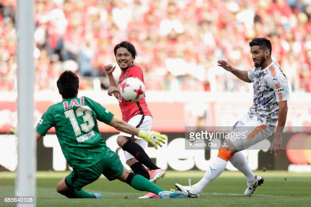 Shinzo Koroki of Urawa Red Diamonds scores his side's third and hat trick goal past Yuji Rokutan of Shimizu SPulse during the JLeague J1 match...