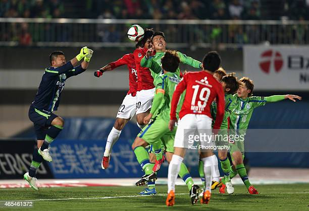 Shinzo Koroki of Urawa Red Diamonds scores his team's first goal during the J. League match between Shonan Bellmare and Urawa Red Diamonds at Shonan...