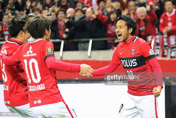 Shinzo Koroki of Urawa Reds celebrates his goal with teammates during the JLeague Championship final match against Kashima Antlers in Saitama on...