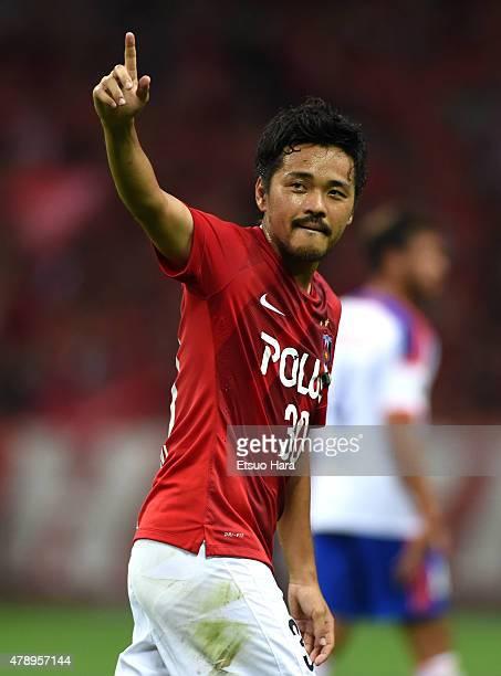 Shinzo Koroki of Urawa Reds celebrates scoring his team's first goal during the JLeague match between Urawa Red Diamonds and Albirex Niigata at...