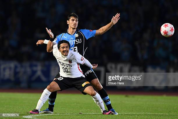 Shinzo Koroki#30 of Urawa Red Diamonds and Eduardo of Kawasaki Frontale compete for the ball during the 96th Emperor's Cup fourth round match between...
