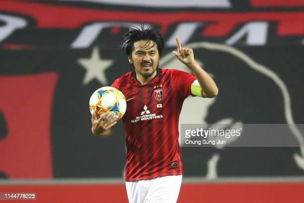 Shinzoh Kohrogi of Urawa Red Diamonds reacts after a scoring a first goal during the AFC Champions League Group G match between Jeonbuk Hyundai...