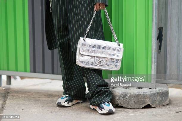 Shioban Bell poses wearing an Acne Studios suit Adidas Yeezy Boost shoes and a Chanel bag after the Comme des Garcons show at the Pavillion Cambon...