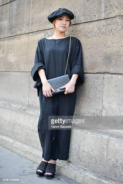 Shiomi Nibu poses wearing a Chanel bag and Bitter Chocolate dress before the Dice Kayek show at Ecole des Arts Decoratifs on July 6 2015 in Paris...