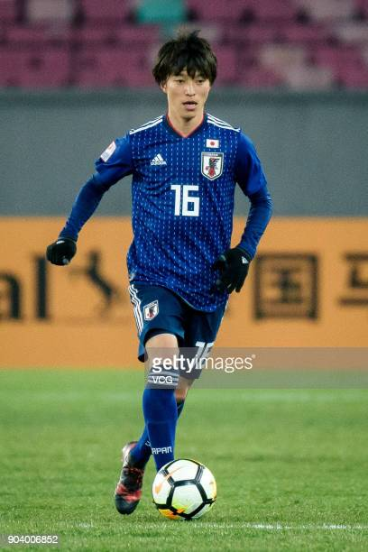 Shion Inoue of Japan and Michel Termanini of Palestine compete for the ball during the AFC U23 Championship Group B match between Japan and Palestine...