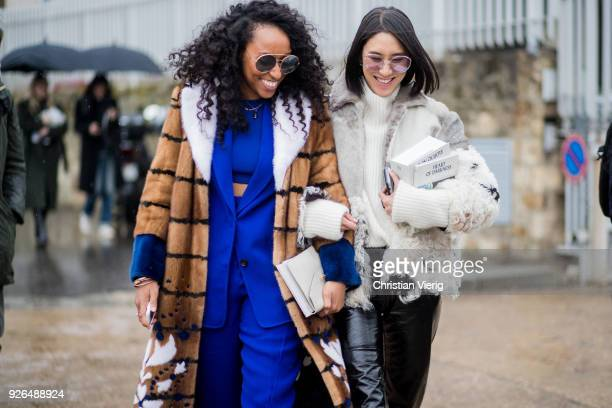 Shiona Turini and Eva Chen outside Loewe on March 2 2018 in Paris France