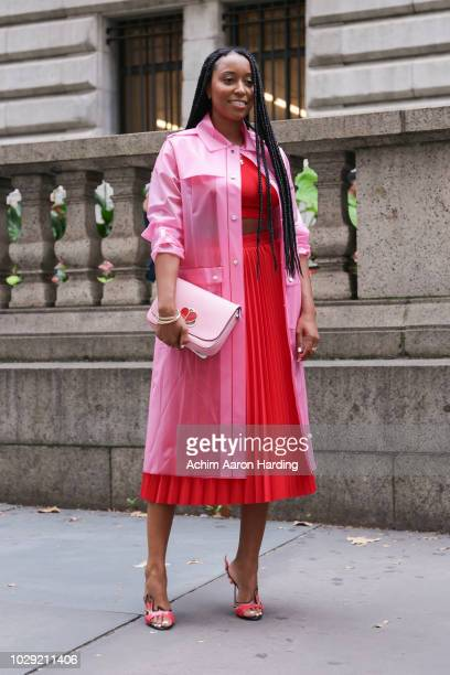Shiona Turini is seen wearing a pink Kate Spade coat a red Balenciaga dresS and pink Kate Spade bag and red Prada shoes on the street during New York...